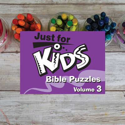 Children's Bible activies on a desk with crayons